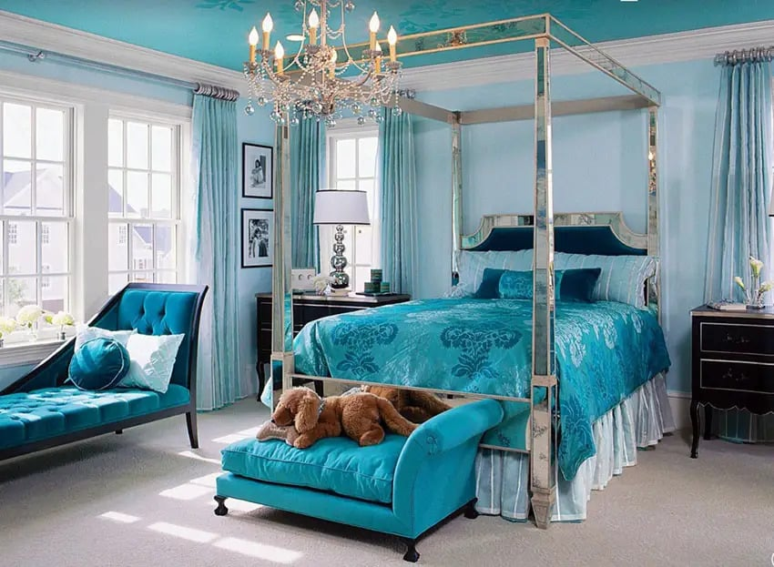 Eye catching blue jacquard bed sheet and sofa bed in master bedroom
