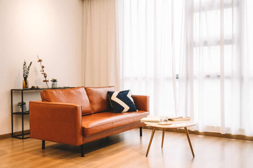Faux brown leather sofa in living room