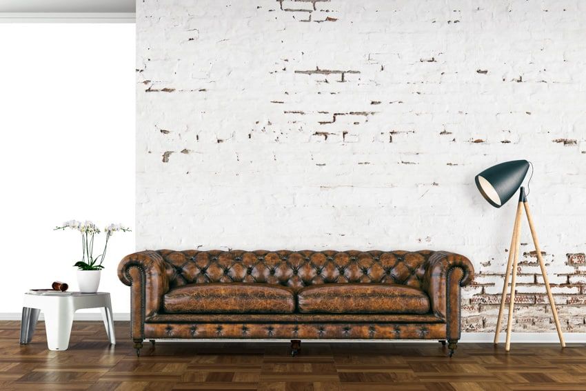 Faux leather couch brick living room