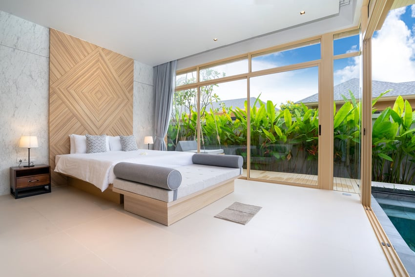Floating bed frame in a cozy and spacious bedroom