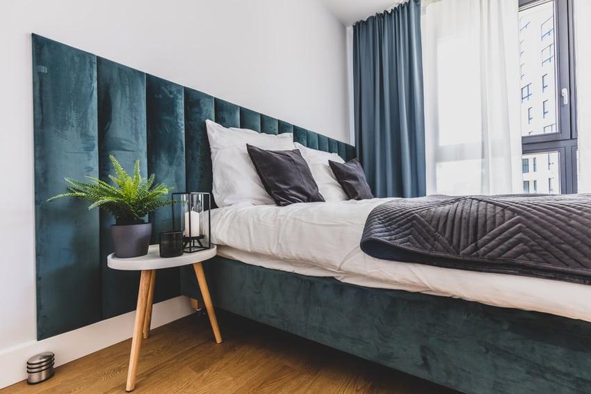 Floating bed in a cozy bedroom interior with vinyl floor