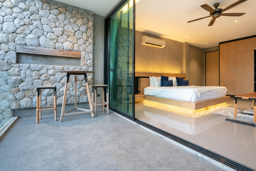 Floating wooden bed frame with accent lighting