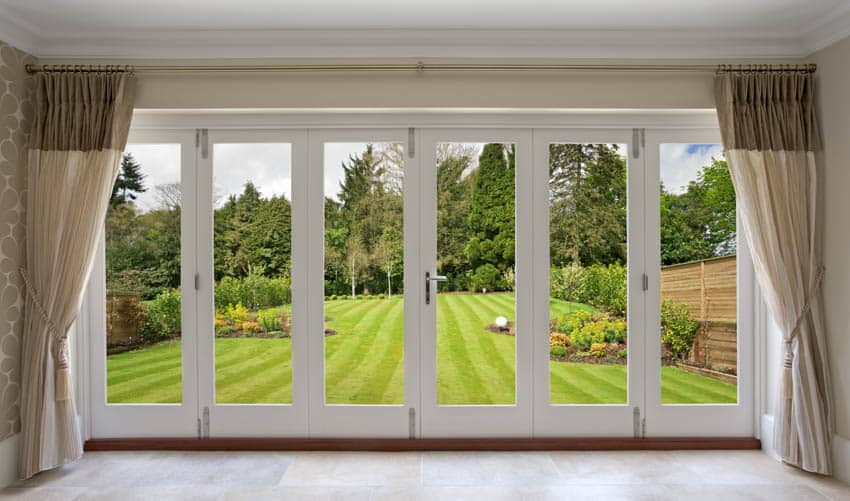 Folding glass door with curtains