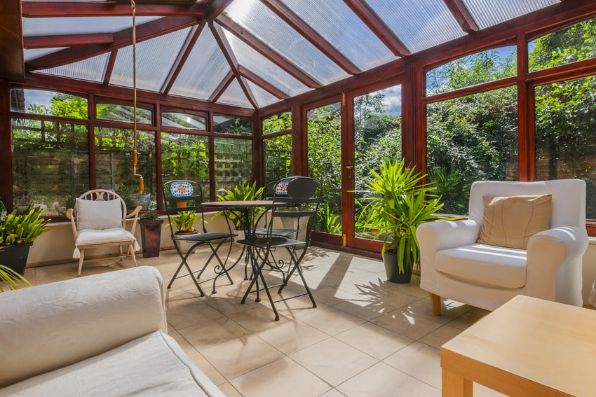 Four season sunroom with various furniture and plants