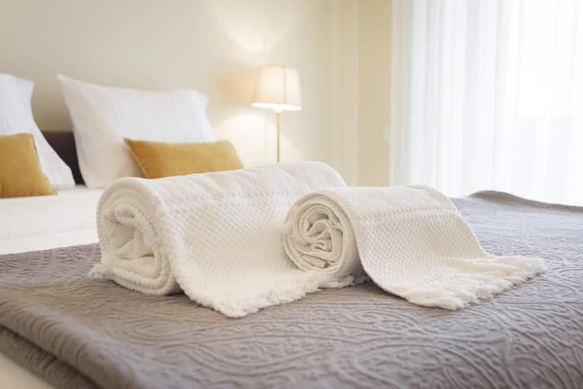 Fresh and clean towels on hotel bed