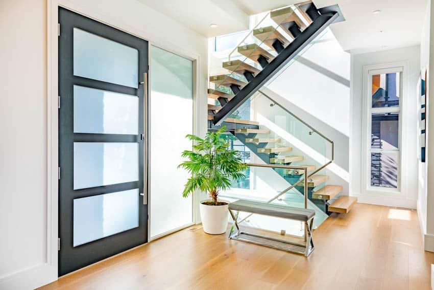 Frosted glass door wood floor indoor plant and stairs