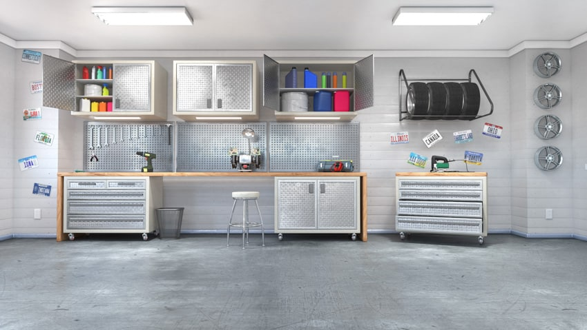 Garage man cave with concrete floor tools and workspace