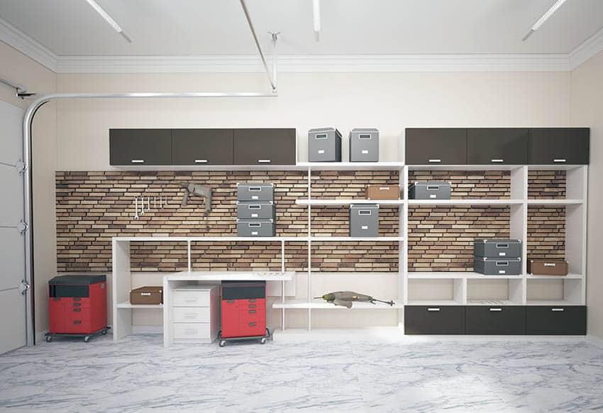 Garage with brick accent wall and shelving