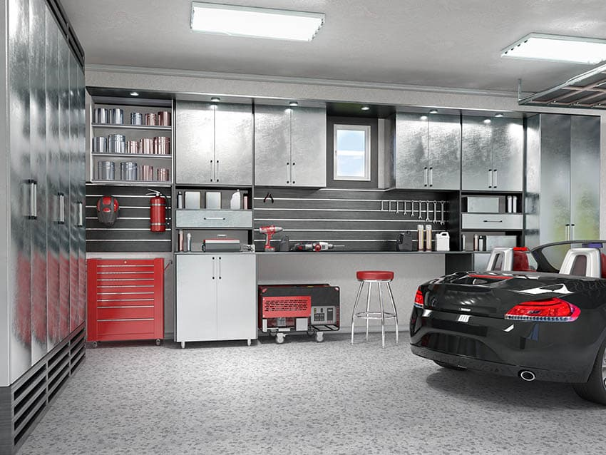 Garage with wall tool storage with recessed lights utility ceiling lighting epoxy floors