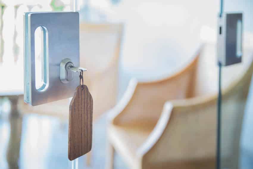 Glass sliding door lock with key