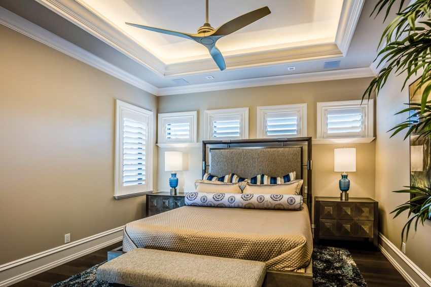 Gold bedroom with ceiling fan