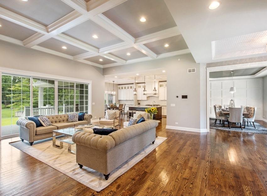 hardwood floors with coffered ceiling elegant furniture and large windows