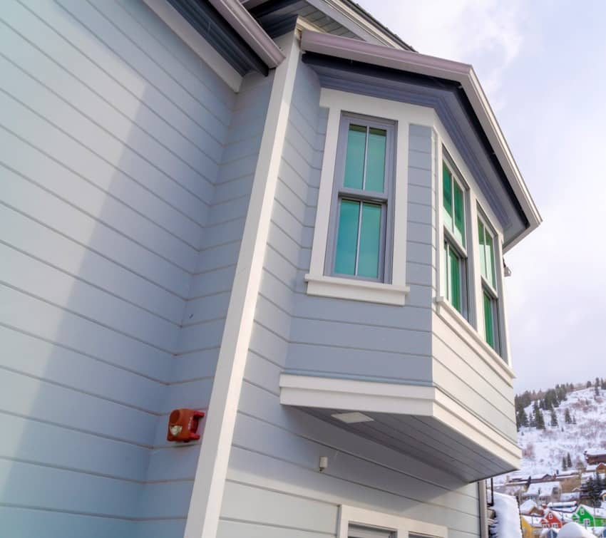 home exterior with bay window and gray horizontal hardie shiplap siding