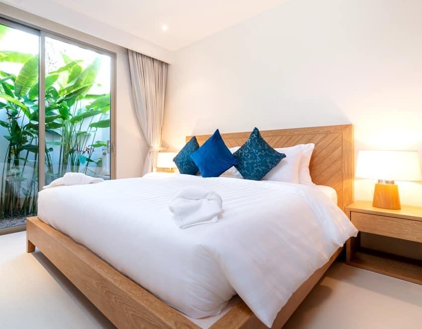 interior design of bedroom with platform bed bedding, duvet and towels