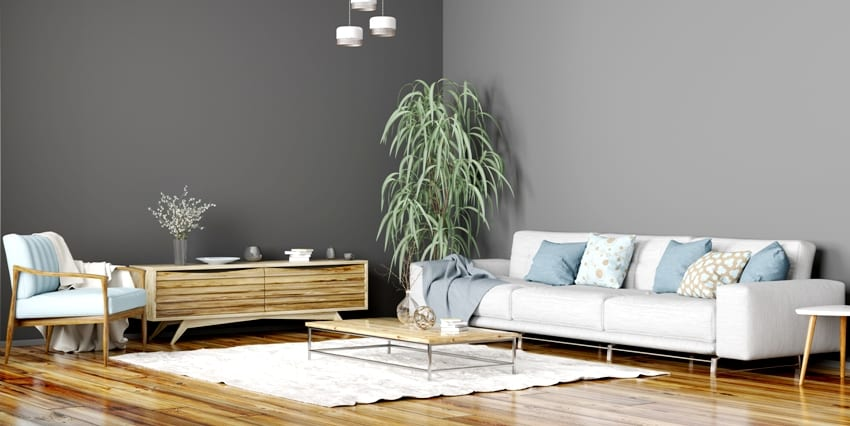 interior design of modern scandinavian living room with grey walls sofa sideboard and blue armchair
