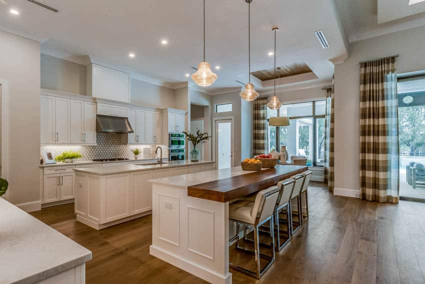 Island with custom seating kitchen with wood floors