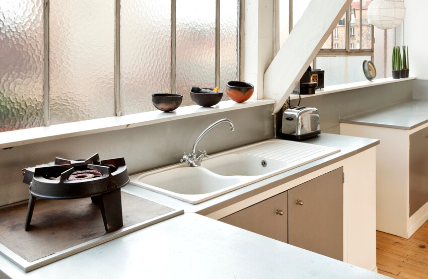 Kitchen cast iron sink with burner and toaster on both sides