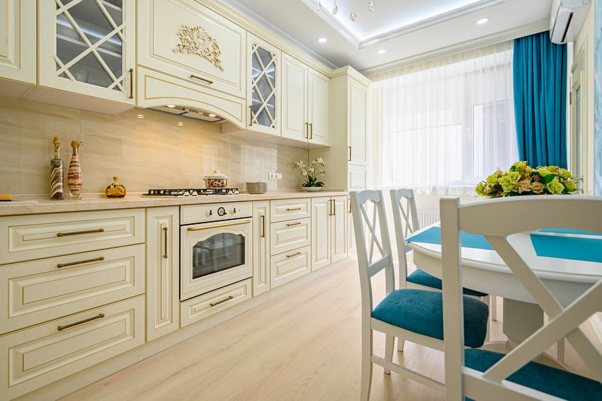 Kitchen with beige white and cyan furniture and accents