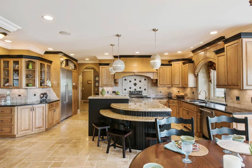 Kitchen with custom island wood cabinets drawers and floors