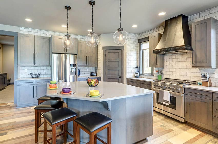 Kitchen with gray chalk paint cabinets and island with white quartz countertops