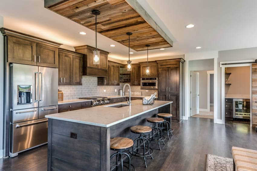 Kitchen with wood accents and custom island with seating