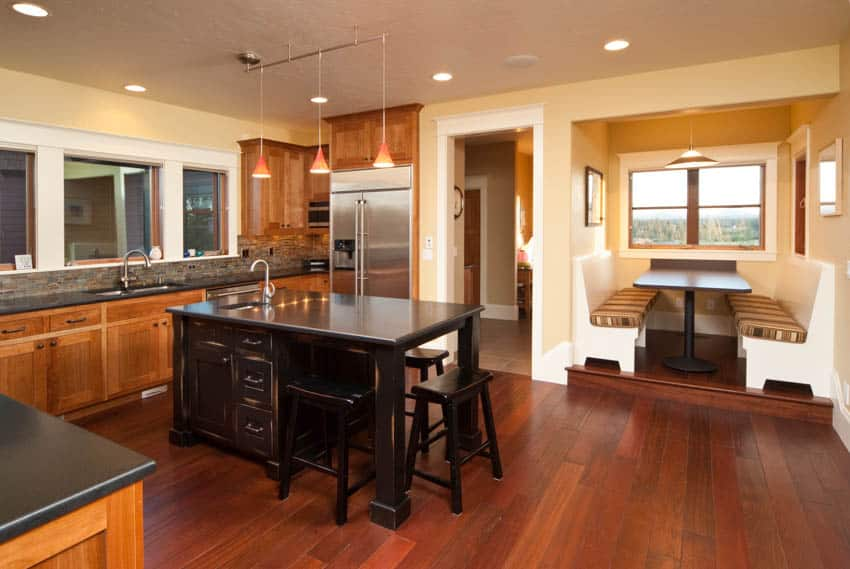 Kitchen with wood flooring cabinet island and booth