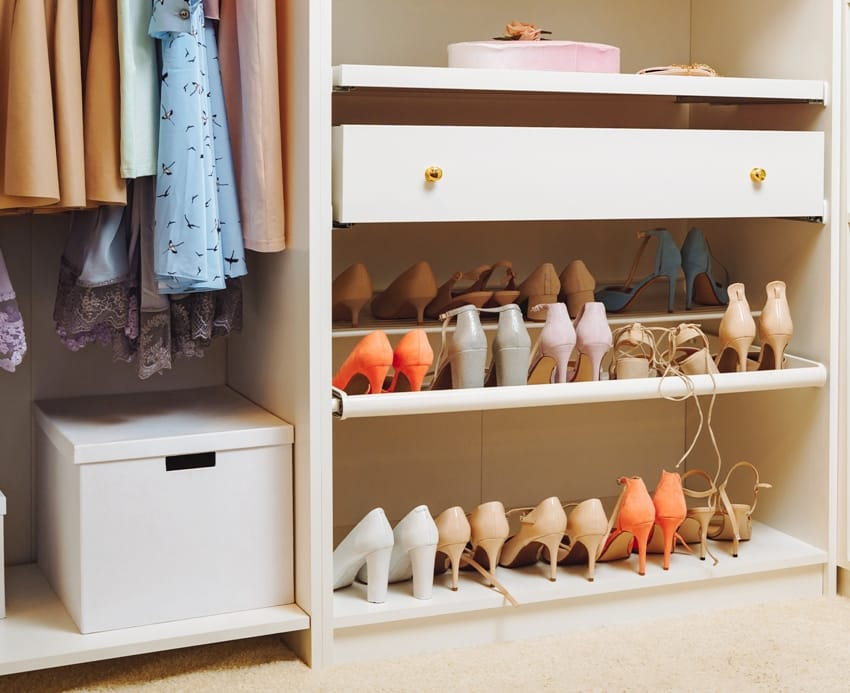 Large wardrobe with stylish womens clothing shoes accessories and boxes