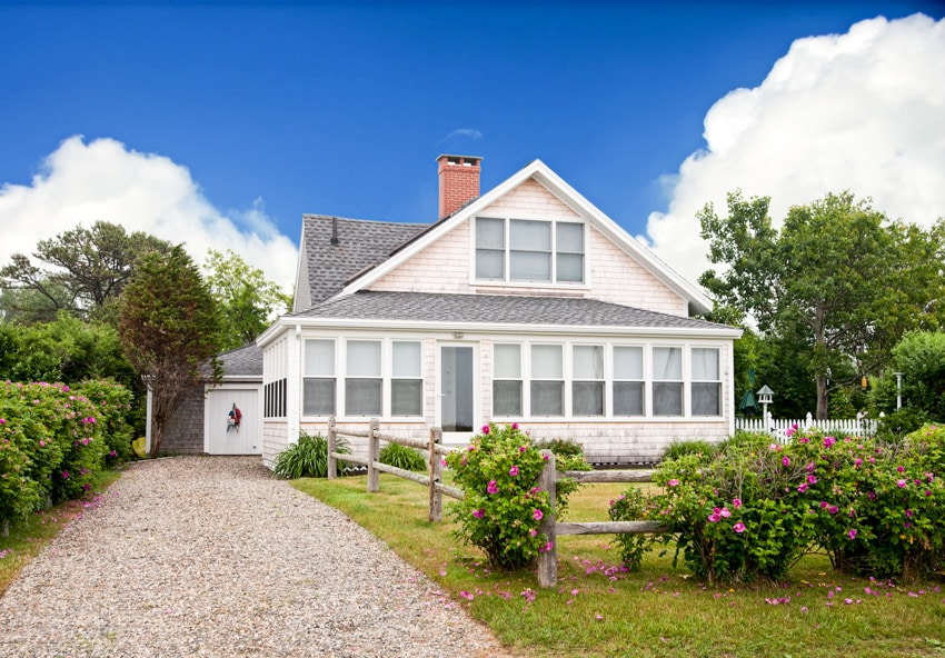 Large white house with chip and seal driveway