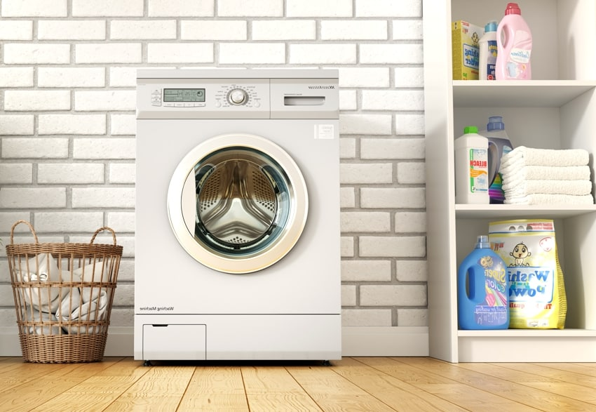 laundry room on a brick wall background with wooden floors detergents on the side and a basket