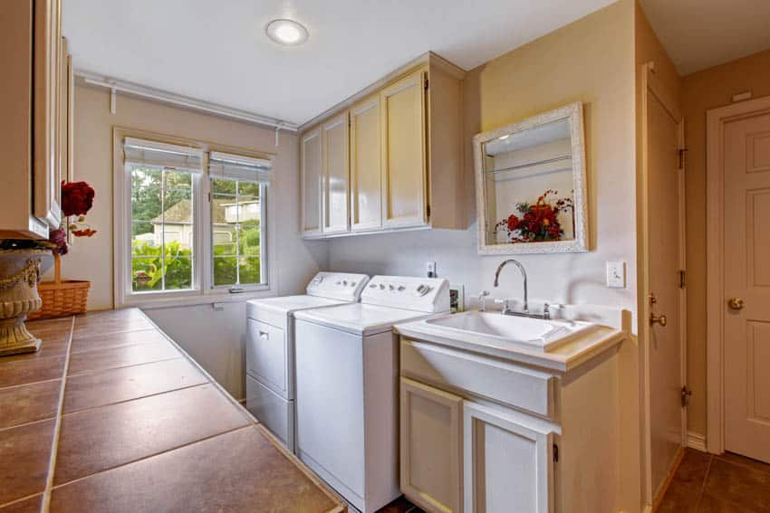 Laundry room with chute and wood cabinets
