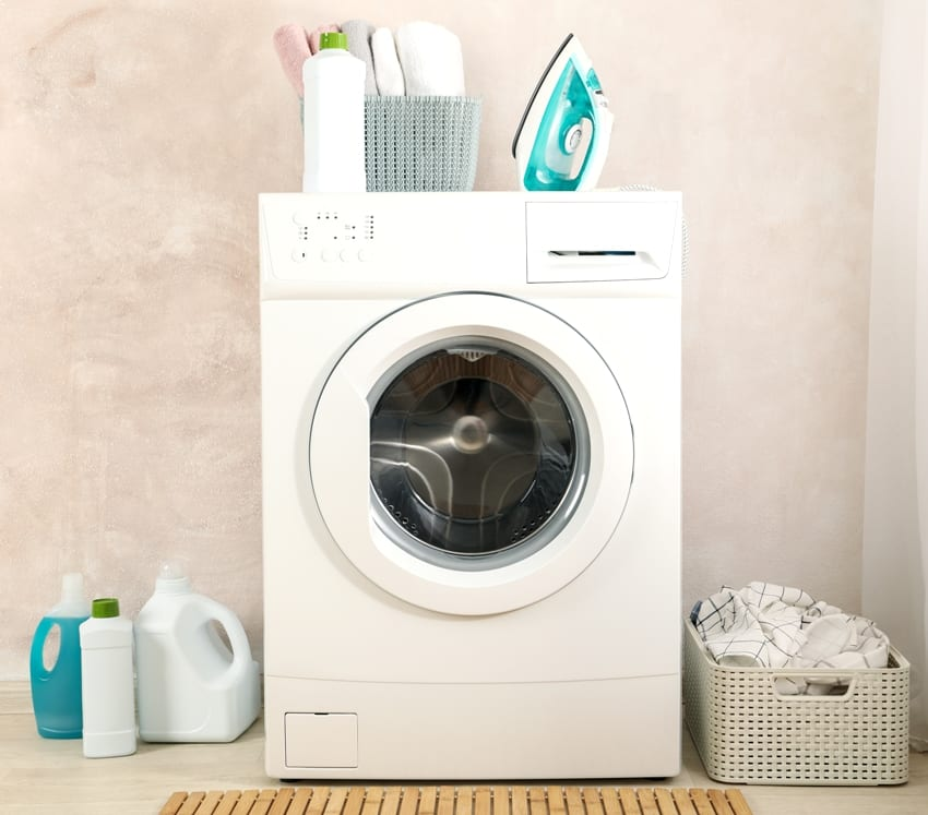 laundry room with washing machine hamper basket iron and detergents