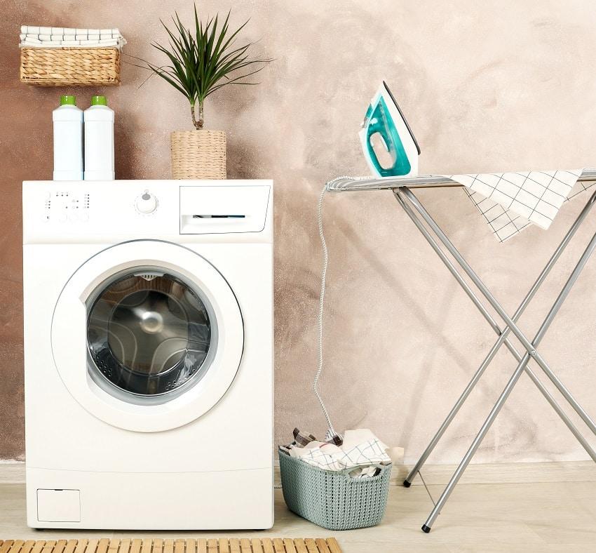 laundry room with washing machine iron hamper basket ironing body and supplies