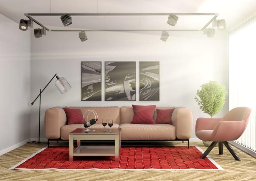 living room interior with gray wall a burgundy carpet on the floor light peach sofa and armchair