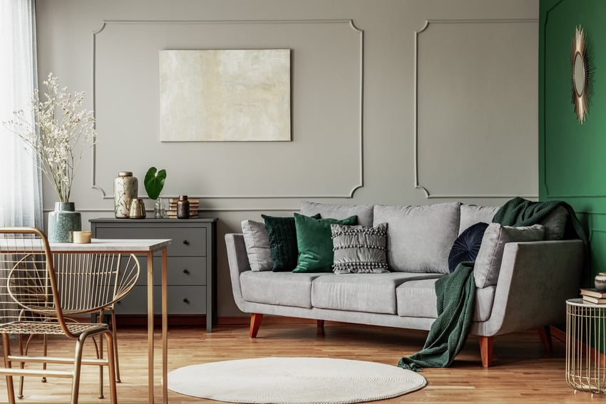 Living room interior with gray walls and green accents