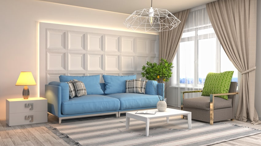 Living room interior with green accent pillow cozy sofas and cotton rug