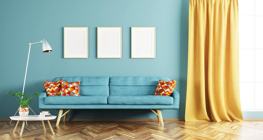 Living room interior with seafoam green walls golden yellow curtain couch and decorative pillows