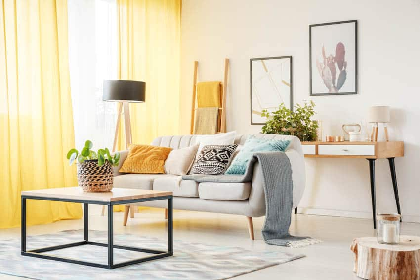 Living room with corner floor lamp window with yellow curtains