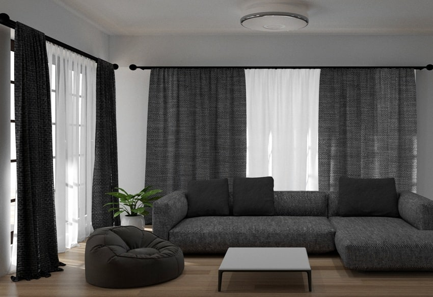 living room with sofa, coffee table and blackout curtains