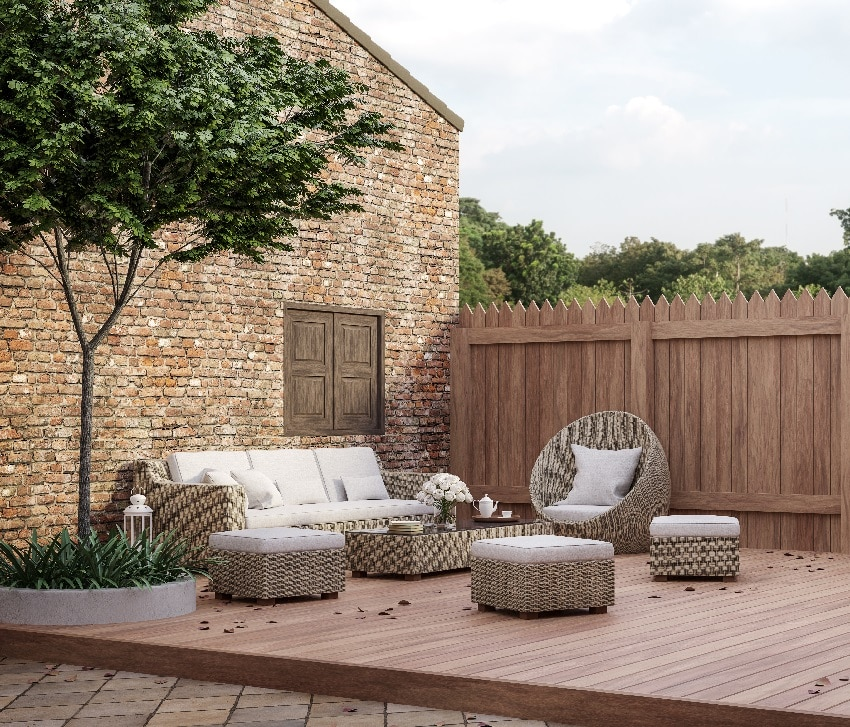 loft style outdoor living area decorated with rattan furniture sets looking out to see the natural scenery