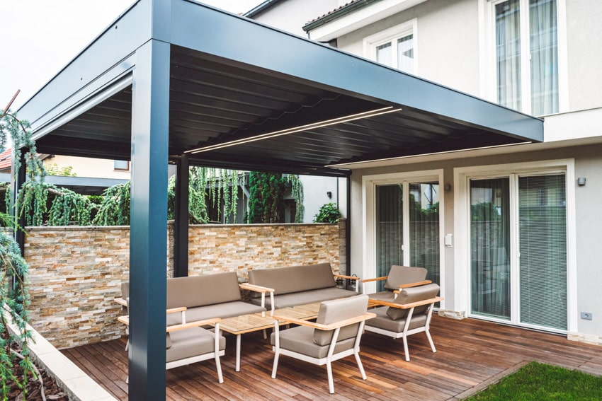 Louvered roof pergola with outdoor furniture under