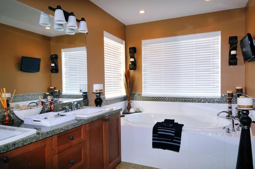 Luxurious bathroom with light fixture bathtub and mirror