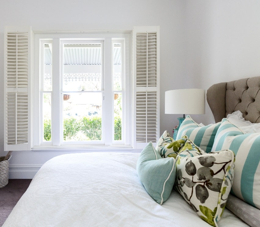 luxury country house bedroom with white interior window shutter a garden view and bed