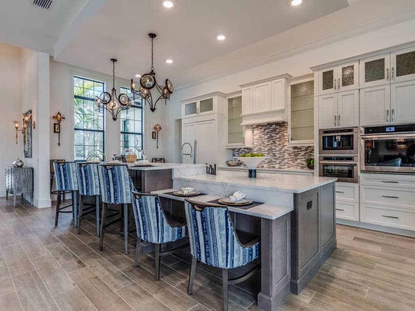 Luxury kitchen with center island wood floors and chairs