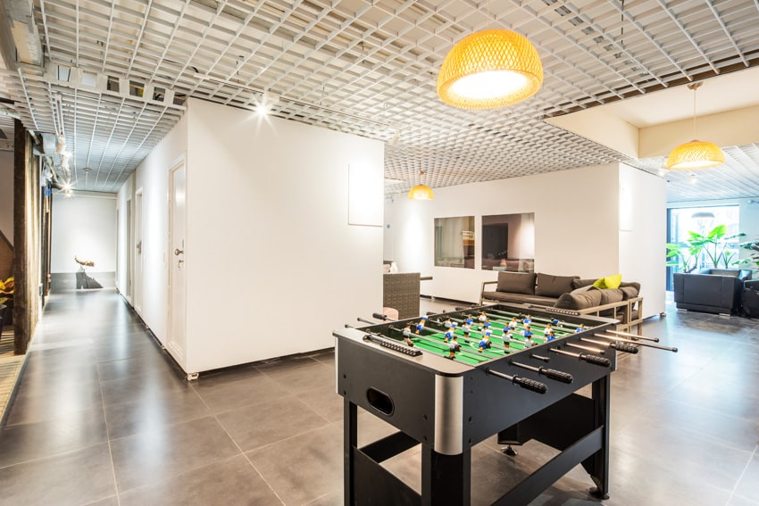 Man cave white foose ball table and tile floor