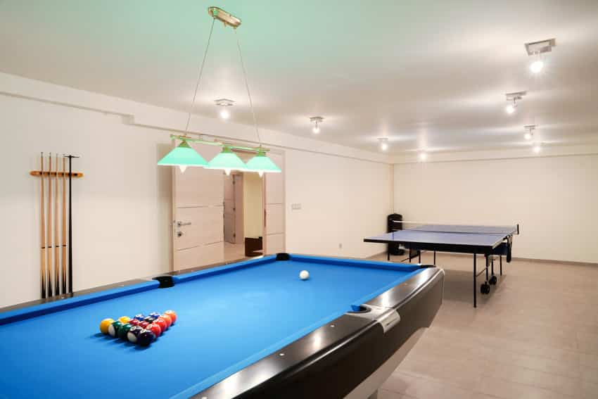 Man cave with billiards table and hanging lights