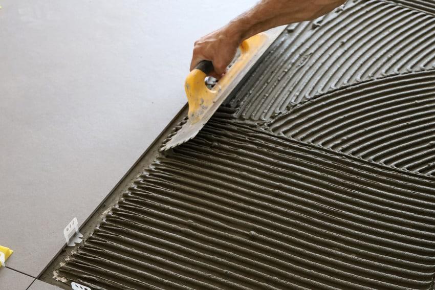 Man resurfacing garage floor