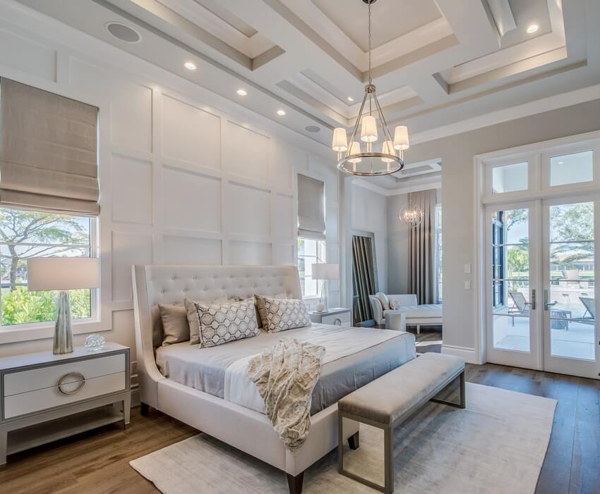 Master bedroom with high coffered ceiling walk out french glass doors and wainscoting wall