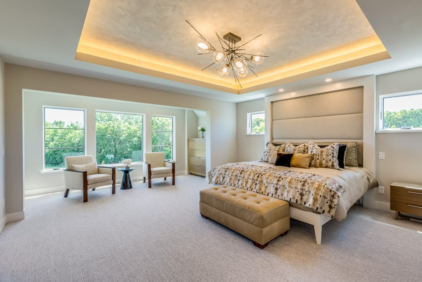Master bedroom with indirect accent light tray ceiling platform bed and gold ideas