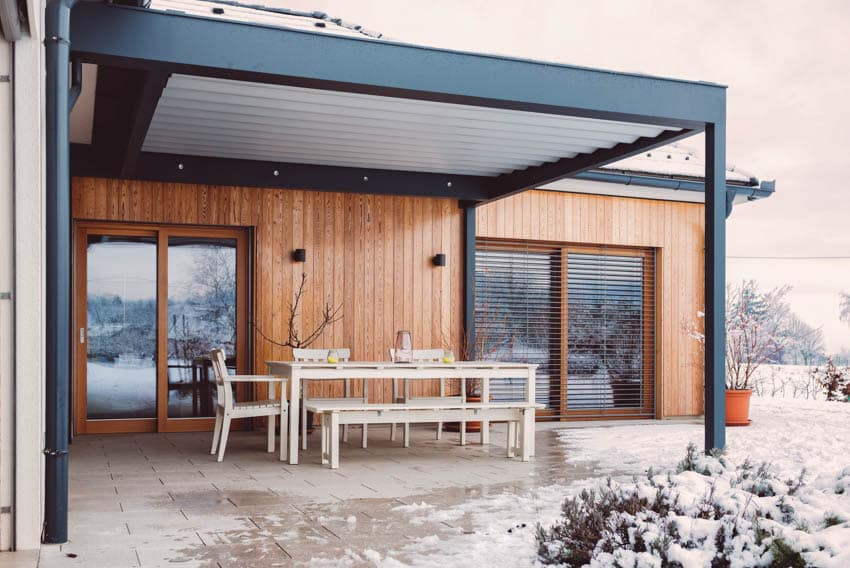 Mirror glass door insulated patio cover on modern home