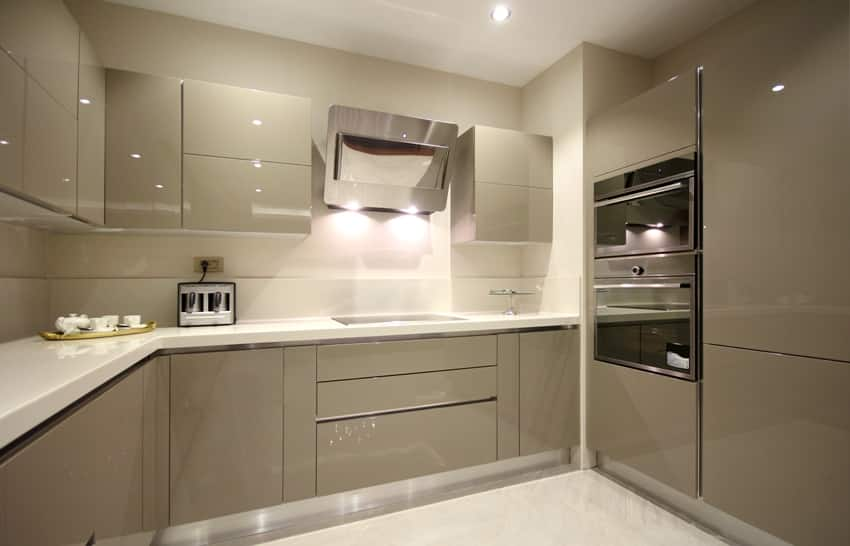 Modern kitchen with gray interior a pvc cabinets and accessorries